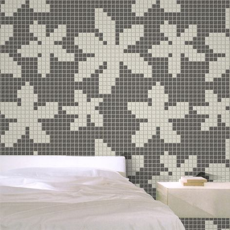 Inspired by the fashion we can offer traditional and innovative design solutions. A porcelain mosaic with concrete effect to the  wall of bedrooms. Decorated with linear cutting machines.   #mosaico #camera #letto #parete #casa #architettura #design #interiordesign #arte #bellezza #eleganza #innovazione #moda #fiori #decorazione #cemento #mosaic #tiles #bedroom #wall #home #architecture #art #beauty #fashion #elegance #innovation #flowers #decoration #concrete