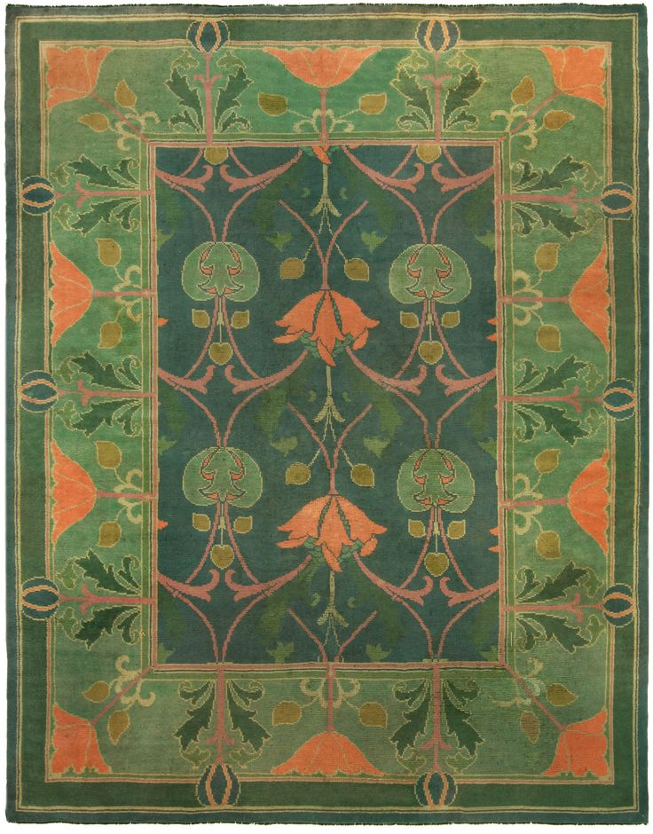 This vintage carpet tapestry features a Charles Voysey rug design. The overall color saturation scale of this piece is a visually pleasant shade of verdant. The central medallion motif features a three columns of plant themed tendril designs. The central rose column motif design symmetrically bisects the length of the rug. On both sides of the central rose tendril design are two rosebud themed tendril design motifs. The thin guard border is a rectangular, root design buffer. The branch and…
