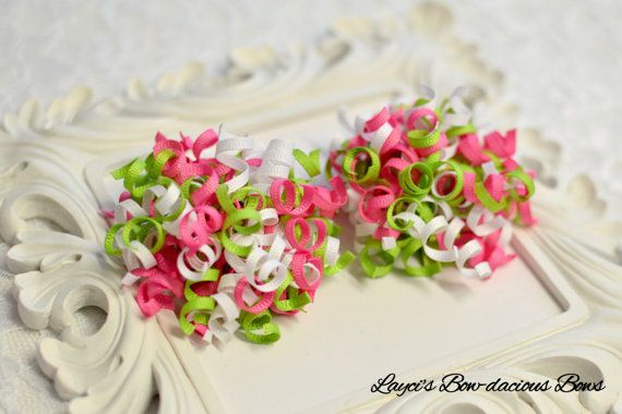 pink, white, green I have been shipping these UNIQUE hair bows all over the world since 2006. If you like korkers you will LOVE these! These bows come in a set of two so they are PERFECT FOR PIGTAILS! They measure about 3 inches each and are made with my tiny korker ribbon.