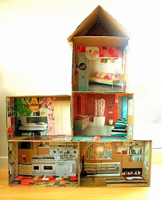 CARDBOARD dollhouse with magazine cut outs as the wallpaper.  What a fun project to do with the kids- LOVE!