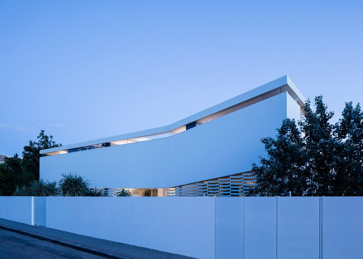 J House by Pitsou Kedem has a perforated facade referencing the traditional regional latticework