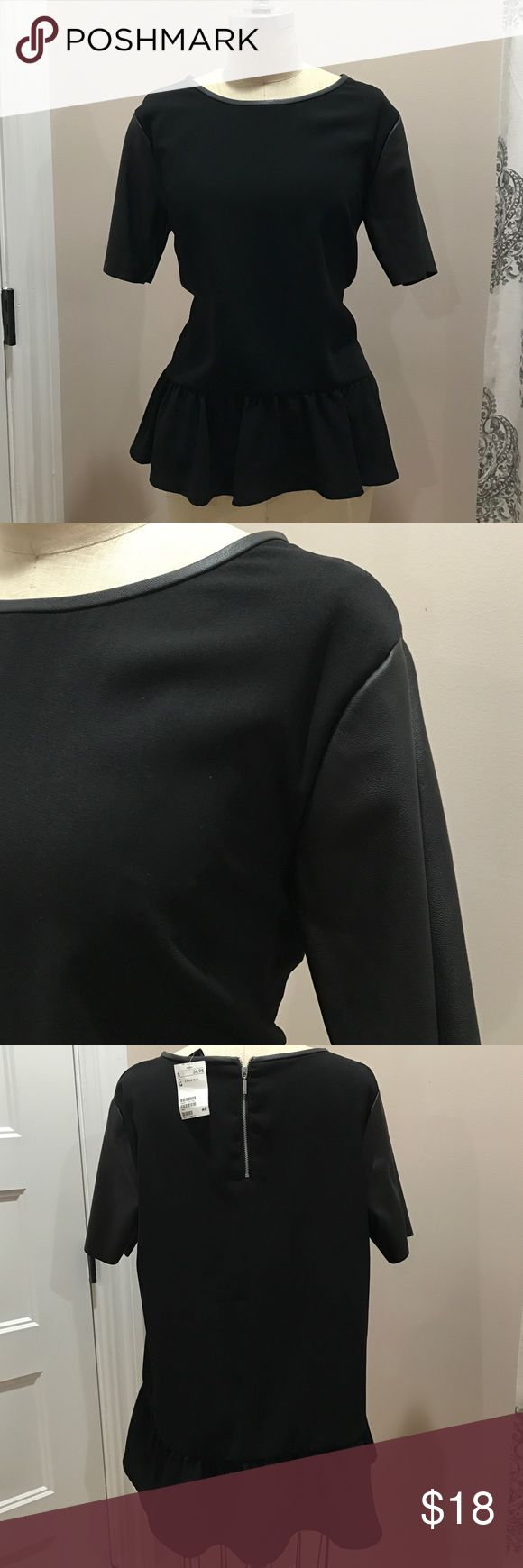Black Peplum Top with Faux Leather Trim Black Peplum Top with Faux Leather Trim. Size 14. Look edgy, classy and so put together all at the same time with this top. H&M Tops Blouses