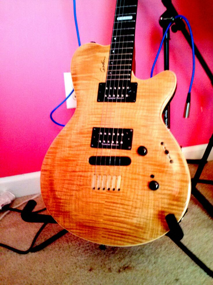 Has Godin Revoicer and Seymour Duncan pickups