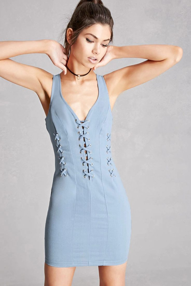 A denim mini dress featuring a plunging neckline with a strappy crisscross front and grommet accents, crisscross straps along the front princess seams, a V-back, sleeveless cut, and an exposed back zipper. This is an independent brand and not a Forever 21 branded item.