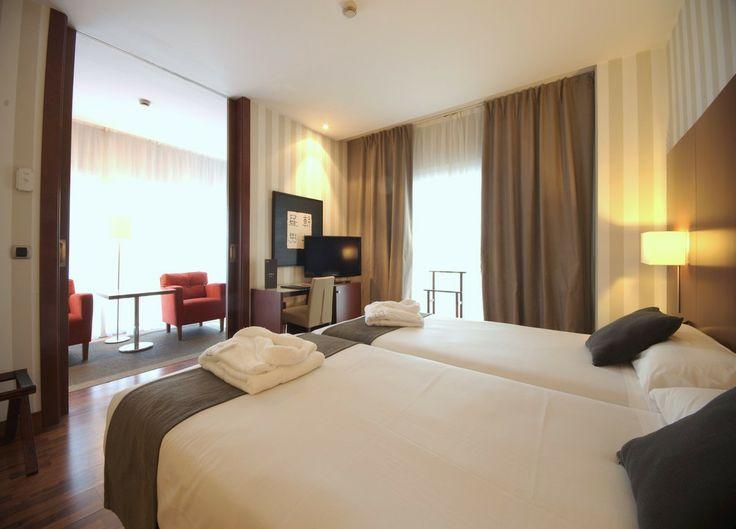 Habitación dos camas con salón