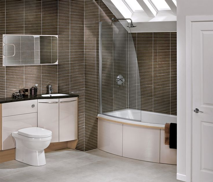 The gentle curves of symmetry make excellent use of the space in this bathroom where a wall-to-wall arrangement of fitted bathroom furniture is required #symmetry #symmertyfitted #bathroomfurniture #myutopia