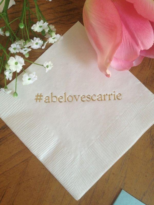 Personalized bar napkins with wedding hashtag for wedding reception.