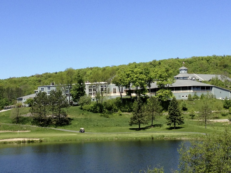 View of the Main Lodge of Deerhurst from the beach. Golf courses in the background.