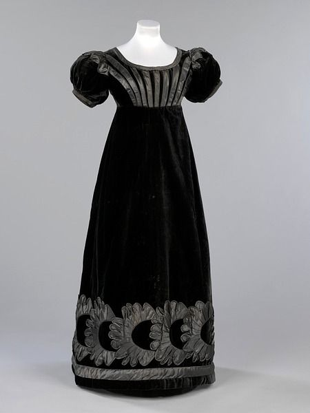 "V& A Museum, item no T.73-2010.  Mourning Dress, Scotland (Britain): c1823-1825, silk velvet, with silk satin piping and appliqué. ""The death of Princess Charlotte in 1817, the only child of George IV plunged the whole country into mourning & set the high standards for mourning dress"""