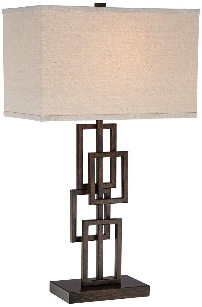 Kory Stacked Rectangles Bronze Table Lamp. Contemporary table lamp. Dark bronze finish. Stacked geometric rectangular design. Metal construction. Rectangular lamp shade.