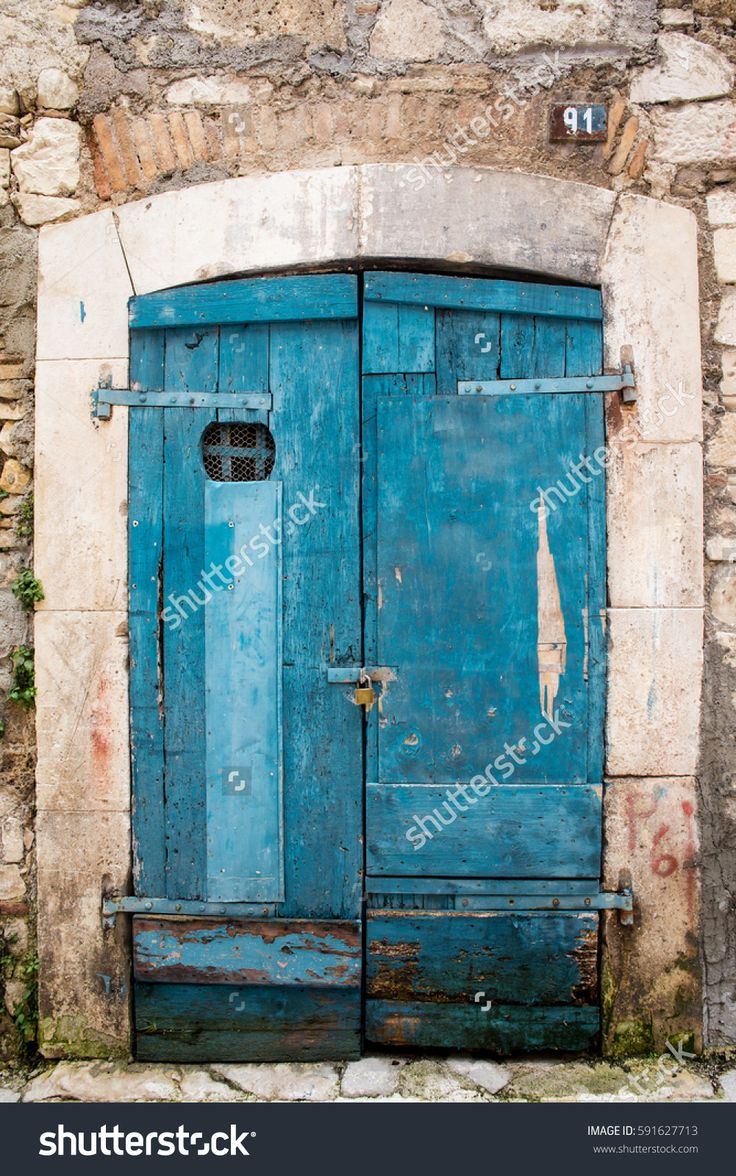 old wooden blue doorway and brick and stone facade