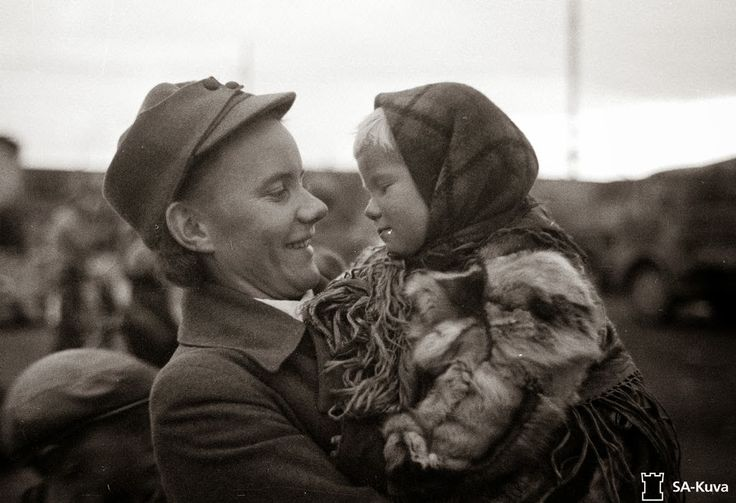 Finnish Lotta with a Finnish child being evacuated from Enare via Rovaniemi, 1944.