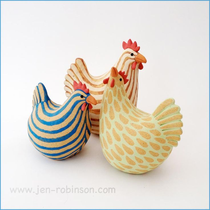 Three hand-modelled hens in stoneware clay, decorated with coloured slips and fired to 1250°C