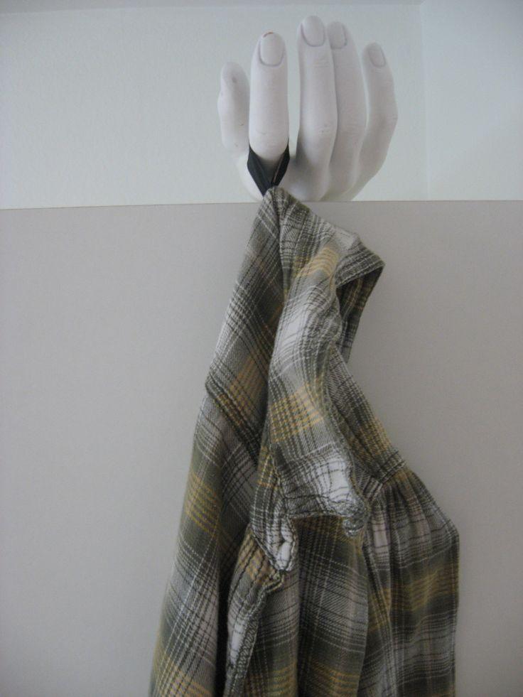 Fake hand coat rack.
