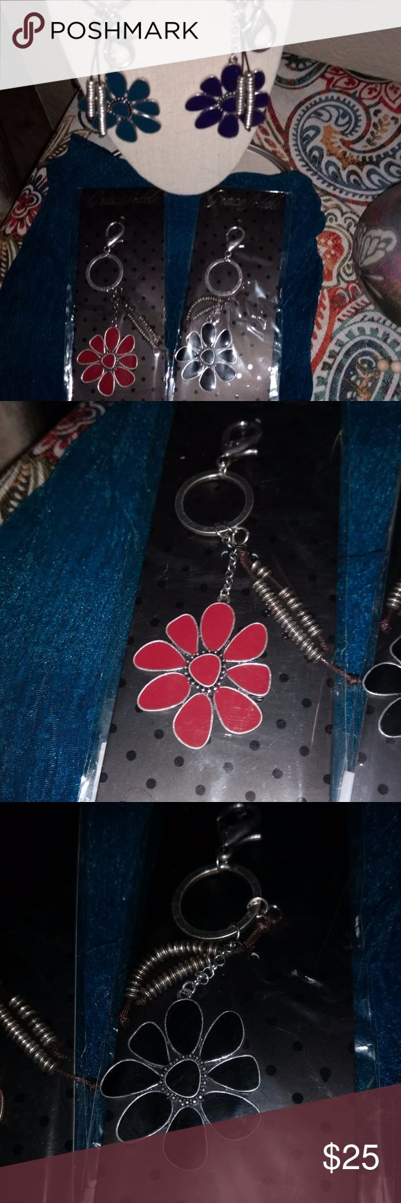 Grace Adele Flower Purse Jewelry / Key Fobs 4 Grace Adele Purse Jewelry / Key Fobs.  You can use as purse decoration or as a key chain.  I am listing together for one price.  If you are interested in only, please leave me a message to say which color you would like.  Black, red, orange and Teal/blue flowers.  4 for $25 or $8 each. Grace Adele Accessories Key & Card Holders