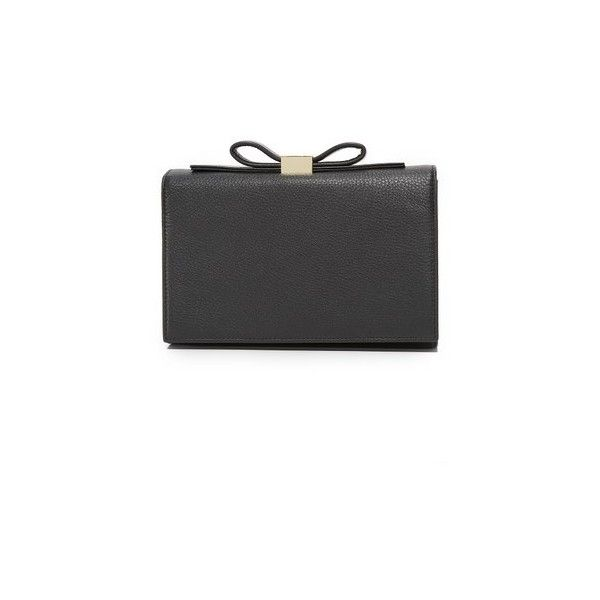 See by Chloe Nora Clutch (€280) ❤ liked on Polyvore featuring bags, handbags, clutches, black, leather flap purse, real leather purses, bow handbag, genuine leather handbags and magnetic purse