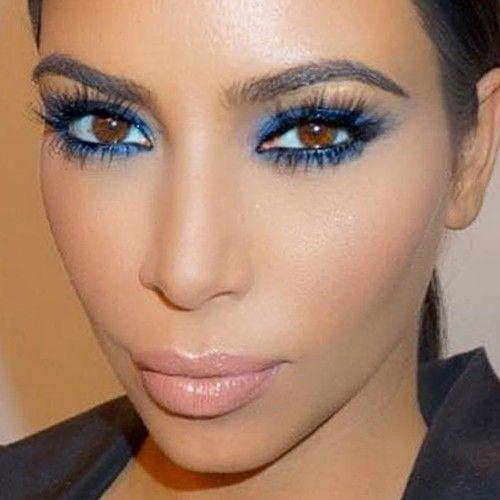 Kim Kardashian had a bright blue makeup that really made her eye pop; makeup by Celebrity MUA Mario Dedivanivic