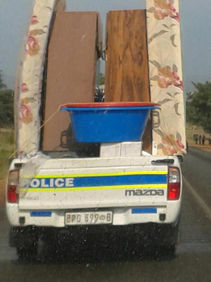 Police vehicle used to move furniture. No wonder the crime is out of control.