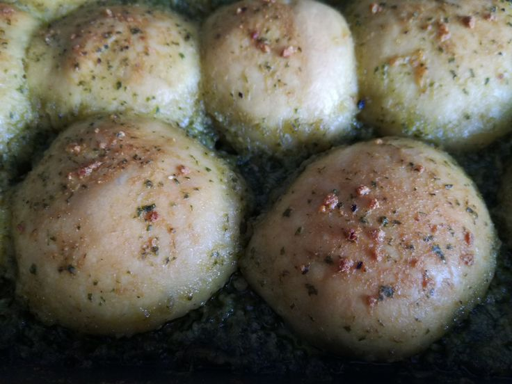 Garlic Doughballs small tasty dough basted with a garlic and basil sauce. Baked to perfection.