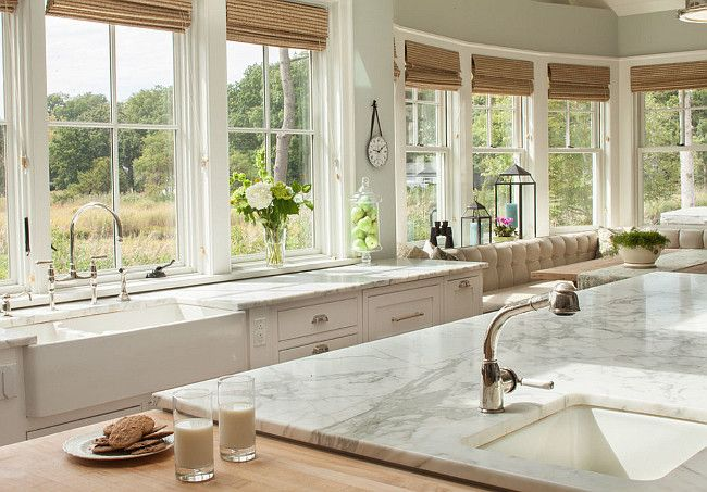 The kitchen island features honed Calacatta Gold and butcher's block countertop. Roman Shades: The bamboo roman shades were custom order from Lowe's.  They're Key Largo from Allen and Roth.