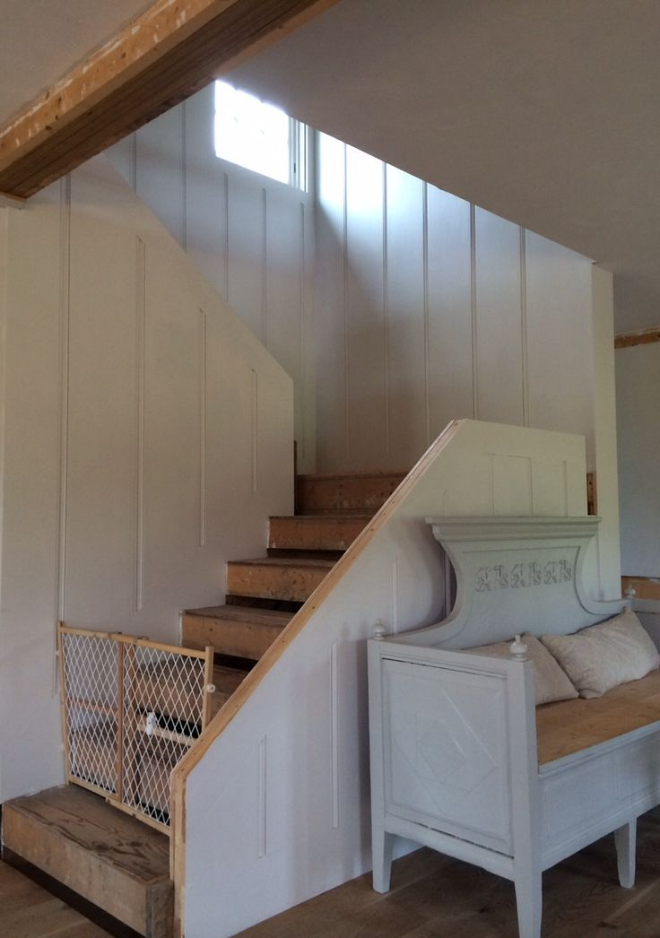 entrance stairwell being built puppy gate in place wide pine paneling painted in farrow - Puppy Gates