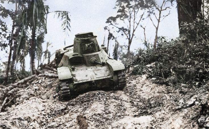 """Disabled Japanese Type 95 """"Ha-Go"""" tank left in Biak, due to Allied advance. The battle of Biak was one of the most important offensives during the Western New Guinea campaign, in which both Japanese commanders died. While Rear Admiral Sadatoshi Senda was killed in action, Colonel Kuzume Naoyuki committed seppuku.  ??/??/1944  #ww2 #colorized #biak #newguinea #tank #type95hago"""