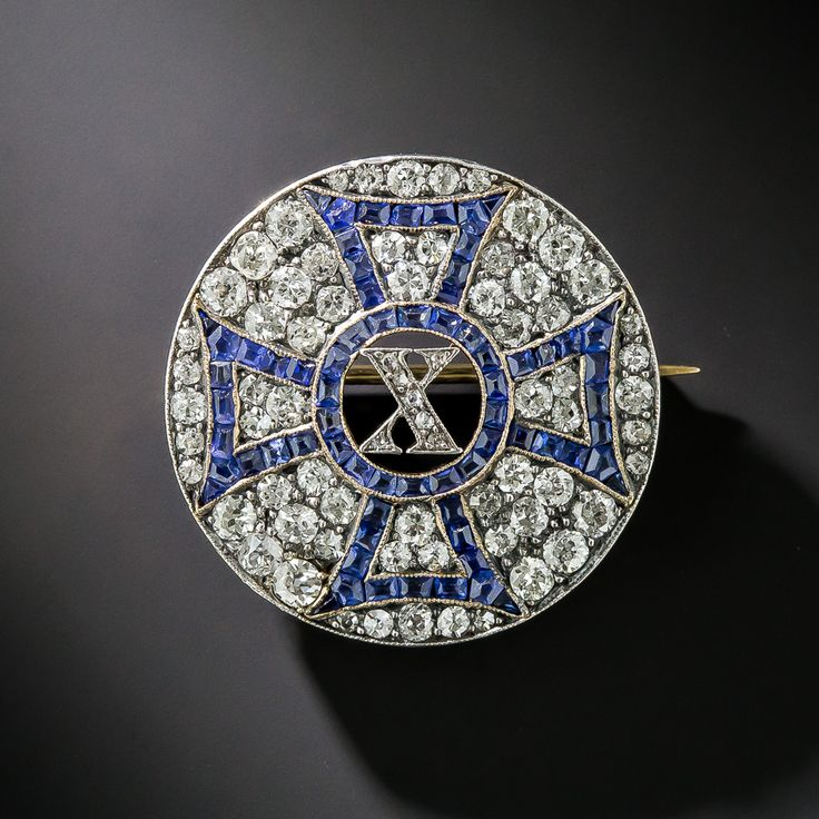 Antique Sapphire and Diamond 'X' Pin expertly hand crafted in platinum over gold and dates back to the early-twentieth century Edwardian period.