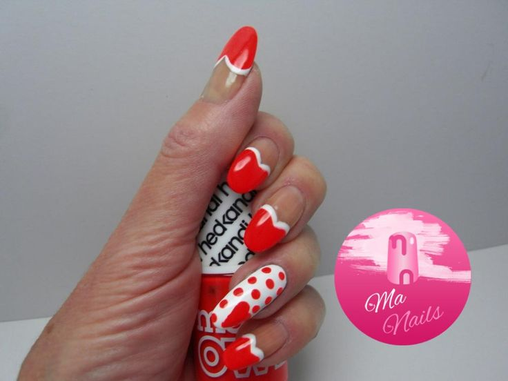 Neon Red Heart Tipped Nails are stunning for Valentines Day. Combines white edged neon red heart tips and a white accent nail with neon red heart and dots.  http://ma-nails.co.uk/neon-red-heart-tipped-nails/