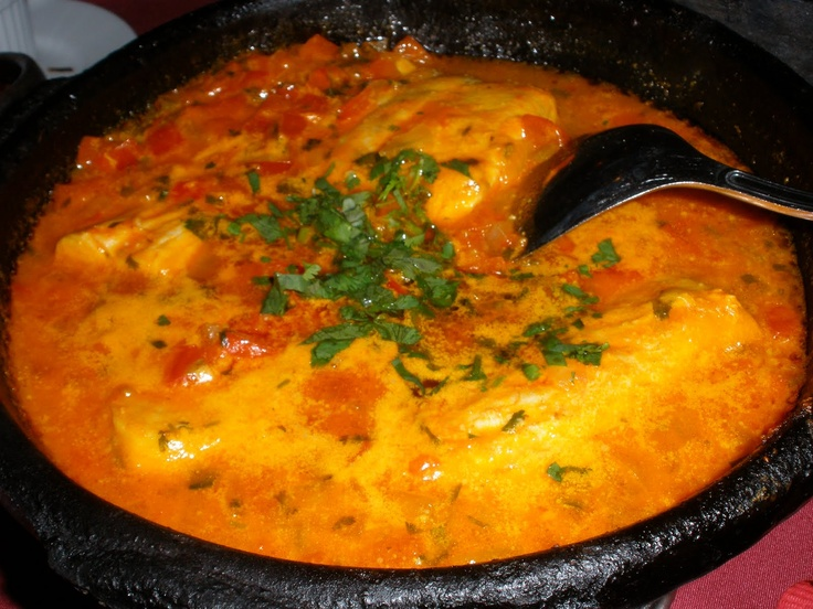 Moqueca - traditional Brazilian stew, made with tomatoes, cilantro, onion, olive oil, and seafood cooked slowly in a clay pot in the oven