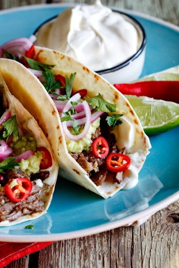 Slow-braised short rib tacos with quick-pickled red onion.
