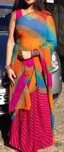 so so colorful chifon sari...This is called 'laheriya' sari..Combination is so so bright and feminine!