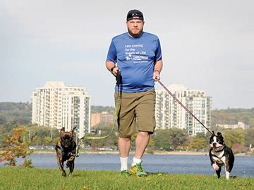 Double lung recipient from Barrie ready for marathon - Rob Burtch takes a walk by Barrie's waterfront with dogs Fenway and Taj. After a lung transplant earlier this year, he'll be walking with family in the Scotiabank Toronto Waterfront Marathon to support Cystic Fibrosis Canada.