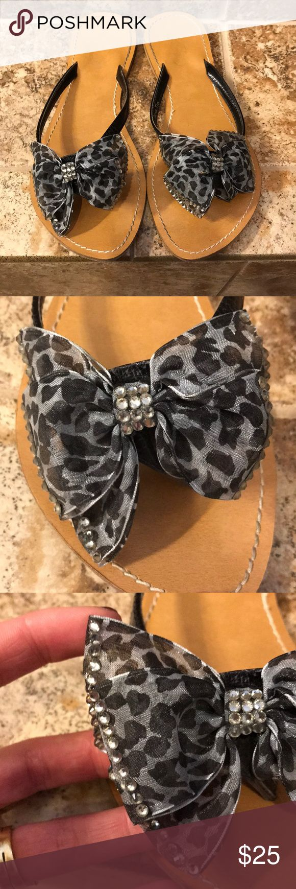 Animal Print and Rhinestone Bow Flip Flops Beautiful animal print and rhinestone flip flops. Black leather thong, the edges of each bow is adorned with rhinestones, as well as the center of each bow. The soles are leather and nice and sturdy. These were only worn a few times. You can see by the condition of the sole there is no wearing or foot print. These have also been sanitized. Size 7 and they fit true. Zero flaws. Perfect for upcoming beach trips or wearing around the pool. SFH…