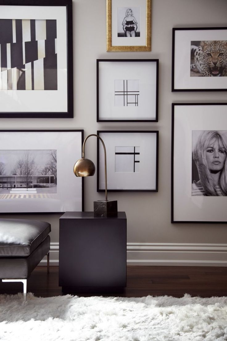A beautiful, modern moment with a contemporary wall grouping. The wide, white mats and black frames add uniformity, while the luxurious pop of gold in the top frame pulls the metallic tones from the lamp and offers a bit of added interest. So lovely!