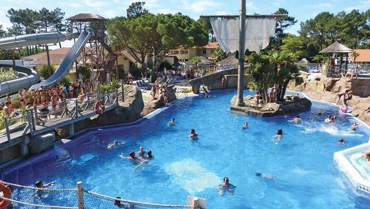 Set under pine trees with easy access to a huge surfing beach nearby, Camping Le Vieux Port also has a great pool complex.