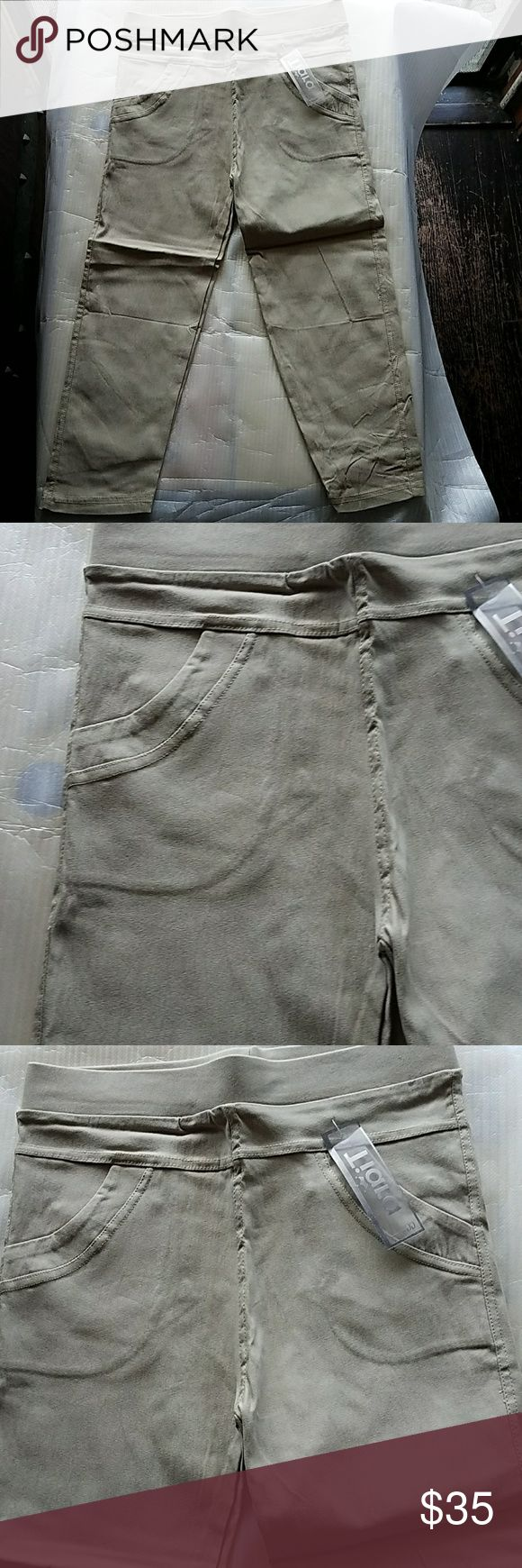 """New Khaki Capri Jeggings New Khaki Capri Jeggings  New with tags It says one size fits all but only fit Small/Medium  Material 70%cotton 25%polyester 5%spandex  Waist measures approximately is 13"""" Rise measures approximately 11"""" Inseam measures approximately 17""""  I do bundle and offers are welcome Boutique Pants Capris"""