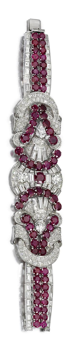 RUBY AND DIAMOND BRACELET, 1930S. The articulated bracelet of geometric plaque design, set with circular-cut and oval rubies, pear-shaped, circular-, single-cut and baguette diamonds, length approximately 176mm. Estimate 36,003 - 45,822USD LOT SOLD. 45,004 USD