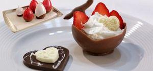 http://thesecretyumiverse.wonderhowto.com/how-to/make-chocolate-dessert-bowls-using-inflated-balloons-0152705/