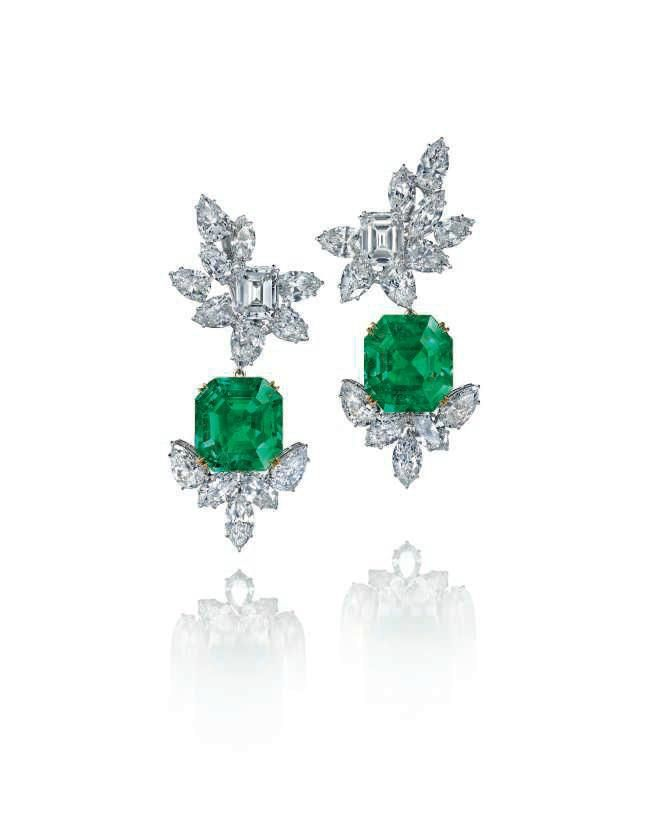 A pair of emerald and diamond earrings, by Harry Winston