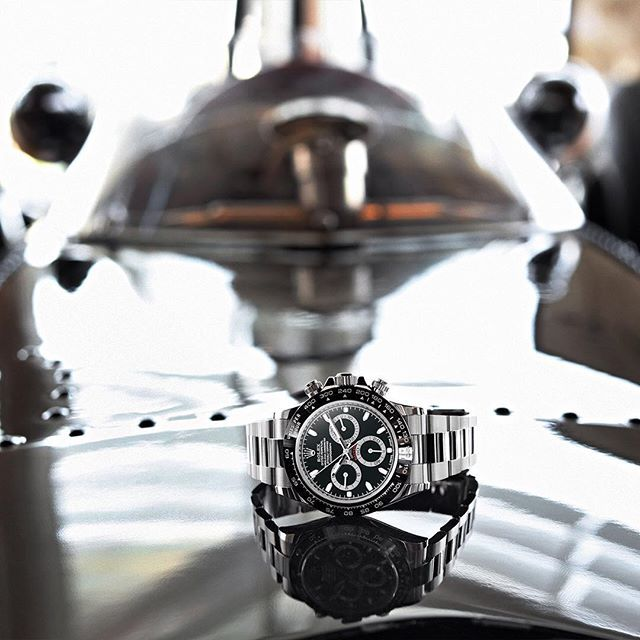 "Sir Jackie Stewart's engraved new Rolex Daytona on top of his original BRM P 261 racing car, celebrating the 50th anniversary of his first Grand Prix win in Monaco. The engraving reads: ""1966 - 2016 50th Anniversary 1st F1 Win Monaco GP"". #Rolex #CosmographDaytona #MonacoGP"
