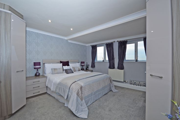 Master Bedroom - The Highlands, Ossett - Property for sale, Richard Kendall Estate Agent; Ossett - Windows, central heating radiator, modern range of fitted wardrobes with matching drawer units.