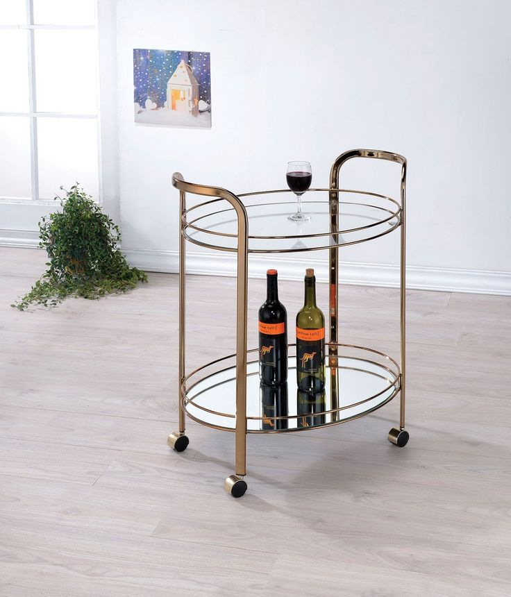 Intended to spruce up any contemporary style kitchen or dining space this ultra-chic champagne finished serving cart is the perfect piece to show off favorite glasses or drinkware. Tempered glass shelves add a reflective touch to enhance the elegant coloring. <br/> This product may take longer than 5 days to fulfill and may require scheduled delivery