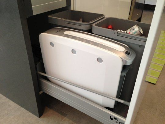 Clean & Organized: Hidden Recycling & Shredding Center in a Kitchen Cabinet