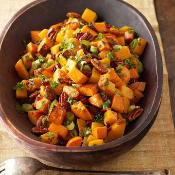 Roasted Sweet Potato and Butternut Squash Salad - This root vegetable side dish uses the best of fall flavors, from roasted winter veggies to nuts and dried cranberries. Lightly spiced with maple syrup, cinnamon, and nutmeg, it's a wonderful addition to any Thanksgiving buffet.