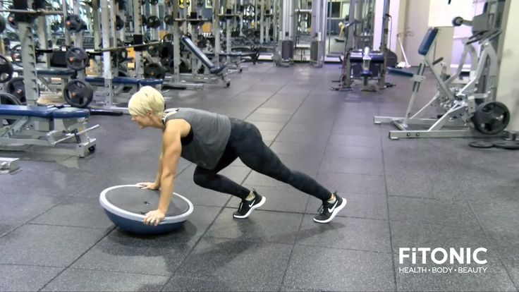 Place the Bosu ball on the floor and grasping it on either