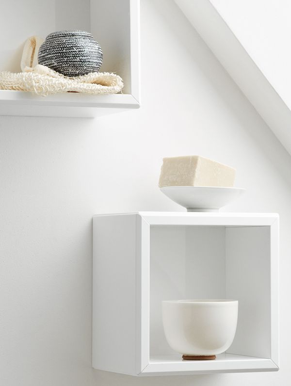 Use the space against the wall for storing items in open, airy cubes.