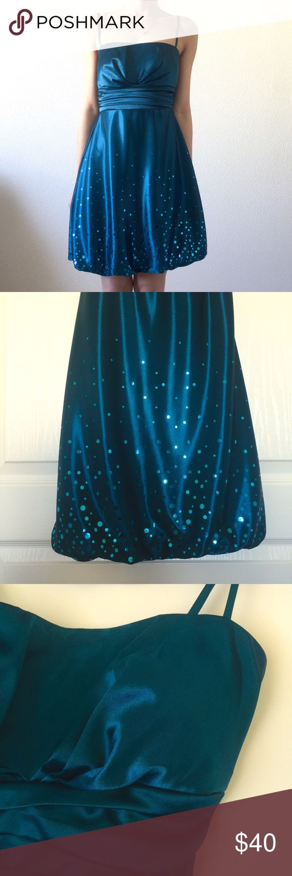 """Teal Dress New. Worn once. No flaws.  The dress is really hard to capture. Closest color is 1st pic, a really rich silky teal. The sequin/sparkle- not sure what to call them- reminds me of bubbling champagne.  Size Guide: Armpit to armpit: 14"""" Waist: 13"""" Length (armpit to hem): 24.5"""" Model measurements: 32A BUST • 24.5"""" WAIST • 32"""" HIP • 5' 2""""  Feel free to shoot me an offer, or ask any questions! :) Speechless Dresses"""