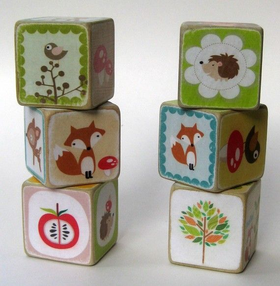 Idea - make my own using wooden blocks, scraps of paper and mod podge.