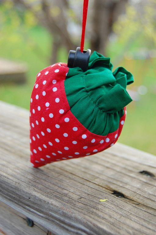 """Tutorial! Little fat strawberries with cord stops  that open out into a spare grocery bag""""  I have several, and use them all the time. So easy to stash in the car so you're never caught out and about w/o a reuseable shopping bag@Rachael Hoeveler Stangle"""
