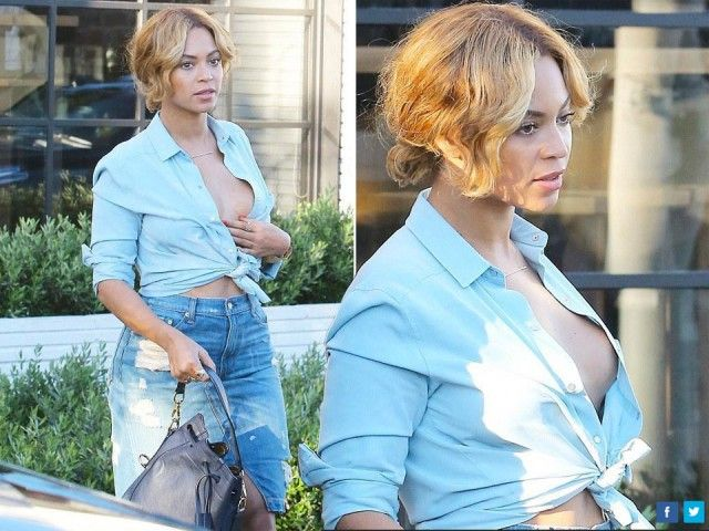 Camicetta azzurra annodata in vita totalmente slacciata è il look che Beyoncé ha scelto per un pranzo con il marito Jay- Z.
